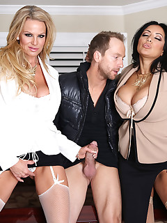 The girls remain clothed, but the nude Ryan gets his cock played with by two hotties with big tits!