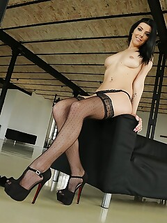 Leggy European brunette modeling solo in stockings and thong