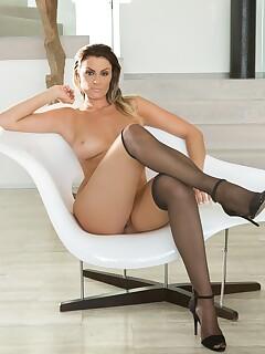 Amazing looking brunette Jordan Monroe provokes while posing in black lingerie