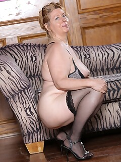 Mature wife strips off her tight dress to show her fatty nude body