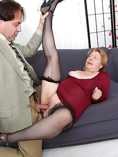 Fat older lady seduces her new lover in a red dress and black nylons