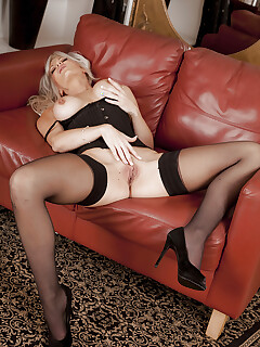 Tall blonde Jennifer Jade posing in stockings and having lots of fun
