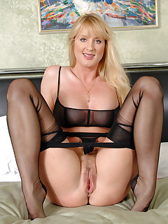 Check out Bethany Sweet as she nails her hairy cougar pussy with a big dildo