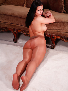 Aria Giovanni  in pantyhose showing off her long legs.